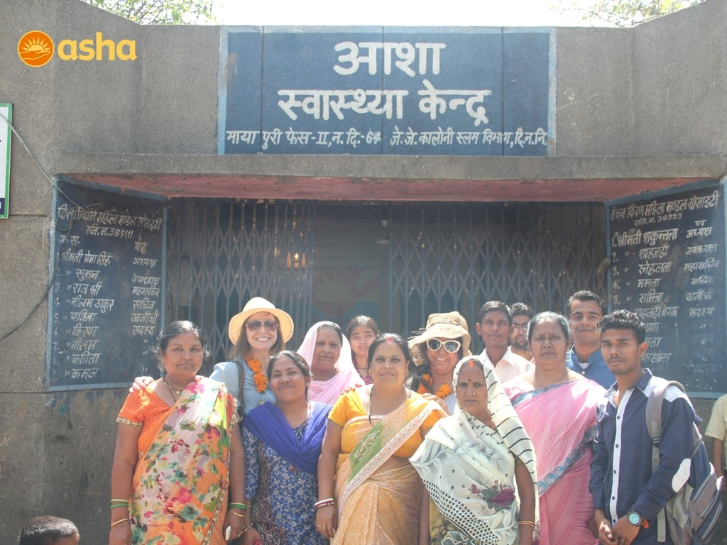 The Asha team at Mayapuri slum community with the guests