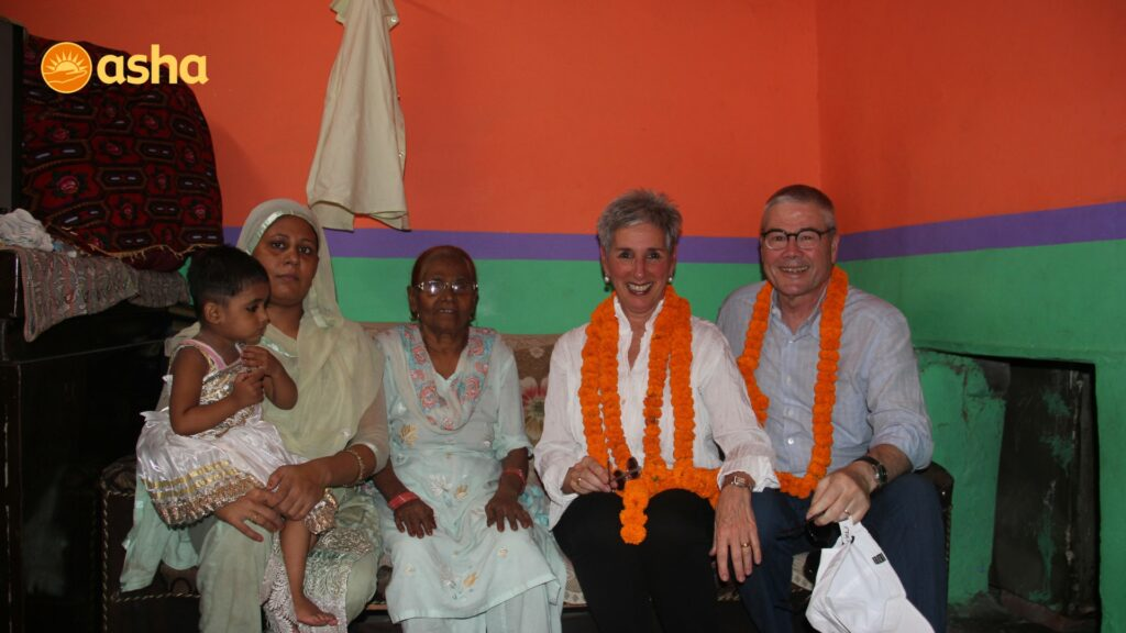HE the Hon. Linda Dessau AC, her husband Mr Howard QC at a slum dweller's house