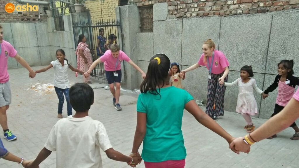 The students playing with the children at Trilokpuri