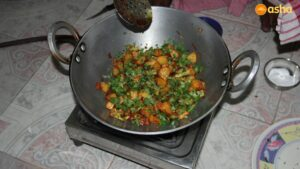 Gobi Aloo being cooked at Trilokpuri