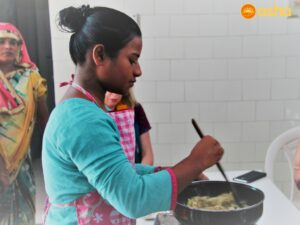 Asha ambassador cooking at Seelampur
