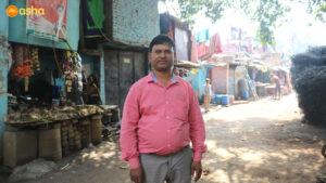 Jay standing at Asha's Mayapuri slum community