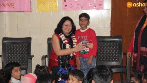 Dr Kiran Martin (Founder and Director) with an Asha's Bal Mandal member at Chanderpuri slum community