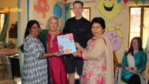 Asha staff presenting a token of love to the teachers of Dunclug college