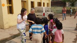Dunclug team conducting an activity with Asha students.