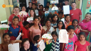 Dunclug team conducting an activity with Asha students