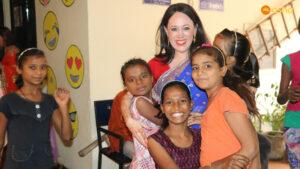 Mrs Victoria Thampi (Wallace High School's teacher) with the Children's Association (Bal Mandal) members