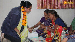 Dr Monica interacting with the Mahila Mandal (Women's Association) members