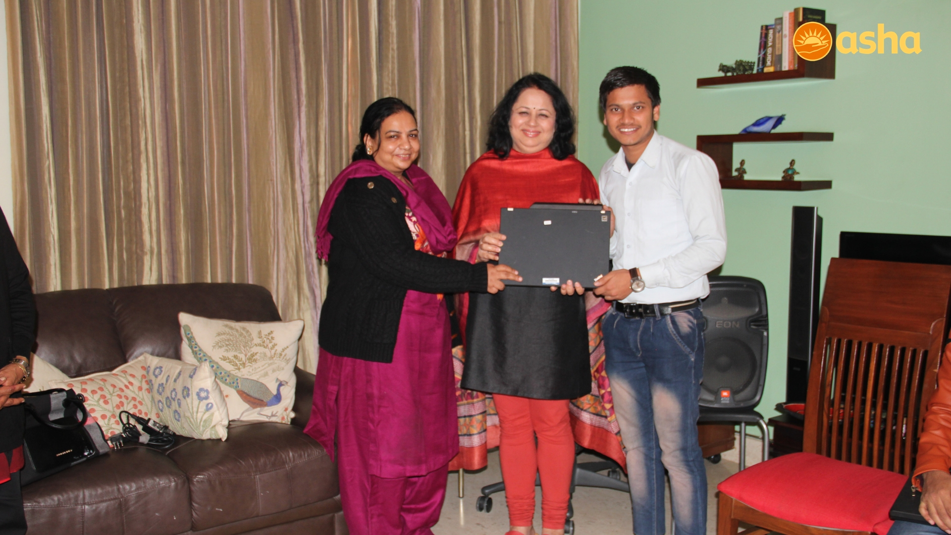 Dr Kiran Distributing The Thinkpads With Love