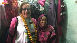 Gilah visiting a slum dweller's shanty