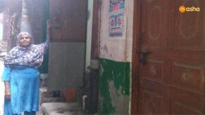 CHV Munni in front of her shanty at Asha's Chanderpuri slum community