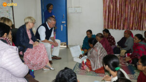 Interacting with the Mahila Mandal (Women's Association) members