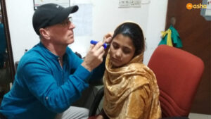 Dr Daniel (Audiologist) seeing a hearing-impaired patient