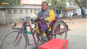 Guddi proudly rides her tricycle