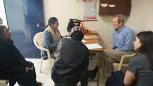 Dr John Peteet (Psychiatrist) attending patients at Seelampur slum community