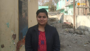 Anjali standing in Asha's Kusumpur Pahari