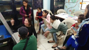 A Trinity team member conducting English class for the Asha students