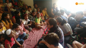 AES students interacting with the members of the Children's Association