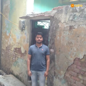 Harshit standing outside his home in Chanderpuri