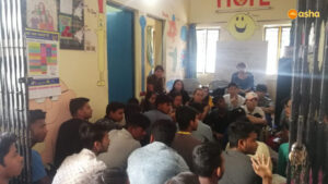 AES students interacting with Asha students