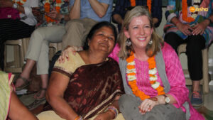 Amanda Clegg with an Asha Mahila Mandal (Women's Association) member