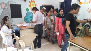 Patients awaiting their turn at Asha's Mayapuri slum community centre
