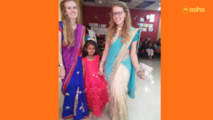 Megan (L) and Jessica (R) with a Bal Mandal (Children's Association) member