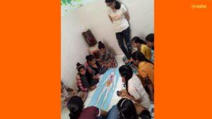 Avantika teaching a topic of Science to the children at Asha's Kalkaji slum community