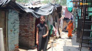 Seema posing outside her shanty