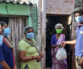 Asha warriors hand out essential groceries to the slum residents