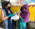 Dr Kiran meets families in Seelampur slum community