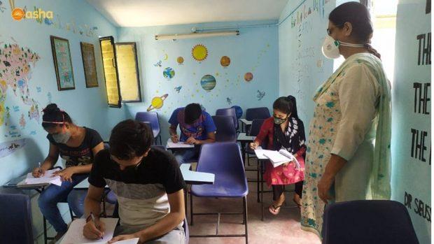 Asha COVID-19 Emergency Response: Asha students prepare to take their online exams at Asha centres