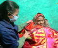 Asha distributes blankets to the elderly in the slums