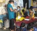 Asha Ambassadors coach younger Asha students in the slums