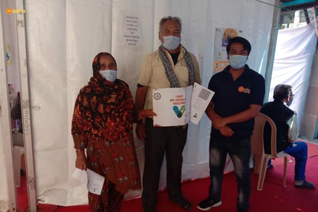 Elderly in Asha slums receive their vaccination